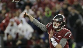 Washington State quarterback Luke Falk (4) passes the ball during the first half of an NCAA college football game against UCLA in Pullman, Wash., Saturday, Oct. 15, 2016. (AP Photo/Young Kwak)