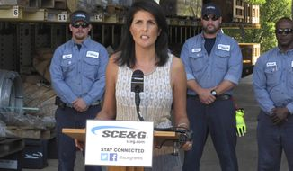 South Carolina Gov. Nikki Haley talks about Hurricane Matthew recovery on Monday, Oct. 17, 2016, in West Columbia, S.C. SCANA Corp. donated to the One SC Fund for hurricane relief. (AP Photo/Jeffrey Collins)