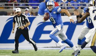 Detroit Lions quarterback Matthew Stafford (9) rushes against the Los Angeles Rams during an NFL football game, Sunday, Oct. 16, 2016, in Detroit. (AP Photo/Rick Osentoski)