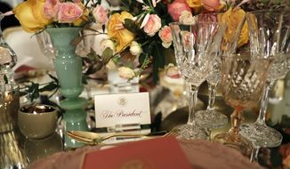 """A place card for """"The President"""" is seen on a table during a preview in advance of the State Dinner in honor of the Official Visit of Italian Prime Minister Matteo Renzi and his wife Agnese Landini in the State Dining Room of the White House in Washington, Monday, Oct. 17, 2016. (AP Photo/Carolyn Kaster)"""