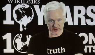 FILE - In this Oct. 4, 2016 file photo, WikiLeaks founder Julian Assange participates via video link at a news conference marking the 10th anniversary of the secrecy-spilling group in Berlin. WikiLeaks said on Monday, Oct. 17, 2016, that Assange's internet access has been cut by an unidentified state actor. (AP Photo/Markus Schreiber, File)