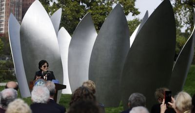 Yoko Ono speaks during the dedication ceremony for her permanent art installation, a sculpture called SKYLANDING, Monday, Oct. 17, 2016, in Chicago. SKYLANDING is Ono's first permanent public art installation in the United States. (AP Photo/Kiichiro Sato)