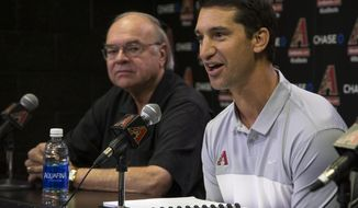 Mike Hazen, right, answers questions, Monday, Oct. 17, 2016, during a news conference in Phoenix. Looking on is Managing General Partner Ken Kendrick. The Arizona Diamondbacks have hired Boston Red Sox general manager Mike Hazen as their general manager. (Mark Henle/The Republic via AP)