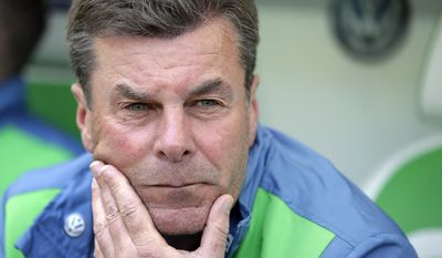 FILE - In this May 14, 2016 file picture Wolfsburg head coach Dieter Hecking arrives for the German Bundesliga soccer match between VfL Wolfsburg and VfB Stuttgart in Wolfsburg, Germany. German media say Wolfsburg has fired coach Dieter Hecking after a poor start in the Bundesliga season, with one win and six points from seven matches Monday Oct. 17, 2016. The Wolfsburger Allgemeine newspaper and the dpa news agency reported the firing, without citing sources. The reports say Valerien Ismael, coach of Wolfsburg's reserve side, will take over.   (AP Photo/Michael Sohn,file)