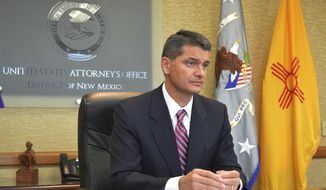 In this Aug. 9, 2016, photo, U.S. Attorney Damon Martinez speaks to reporters from his desk in Albuquerque, New Mexico. Martinez and the U.S. Justice Department announced an agreement with the University of New Mexico on Monday, Oct. 17, to improve how the school responds to student complaints of sexual assault and harassment. (AP Photo/Mary Hudetz)