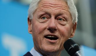 Former President Bill Clinton decried Donald Trump's policies rather than speak about his hot-mic controversies. (Associated Press)