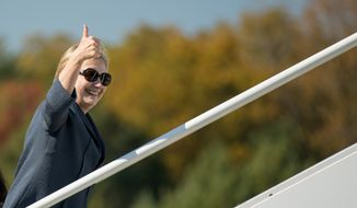 Democratic presidential candidate Hillary Clinton boards her campaign plane at Westchester County Airport in White Plains, N.Y., Tuesday, Oct. 18, 2016, to travel to Las Vegas for the third presidential debate. (AP Photo/Andrew Harnik)