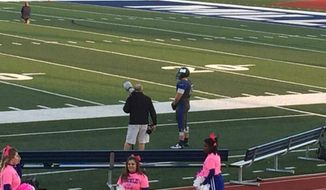 Connor Brewer, a Millikin University football player, remained alone on the field during the national anthem Saturday night after the rest of his team stayed in the locker room. (WAND-TV)