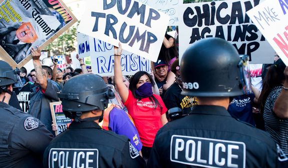 People were hired by Democratic strategists to stir up trouble at rallies for Republican presidential candidate Donald Trump. Officials with Democracy Advocates and Americans United for Change stepped down after a video by Project Veritas Action confirmed their political chicanery. (Associated Press)