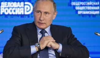 Russian President Vladimir Putin speaks at the Business Russia Congress in Moscow, Russia, Tuesday, Oct. 18, 2016. Putin said that Russia would offer more freedom to private business to help offset the impact of Western sanctions.(AP Photo/Alexander Zemlianichenko, pool)
