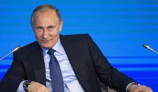 Russian President Vladimir Putin attends the Business Russia Congress in Moscow, Russia, Tuesday, Oct. 18, 2016. Putin said that Russia would offer more freedom to private business to help offset the impact of Western sanctions. (AP Photo/Alexander Zemlianichenko, pool)