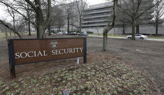 In this Jan. 11, 2013, file photo, the Social Security Administration's main campus is seen in Woodlawn, Md. More than 60 million retirees, disabled workers, spouses and children rely on monthly Social Security benefits. (AP Photo/Patrick Semansky, File)