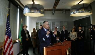 Washington Gov. Jay Inslee, center, speaks Tuesday, Oct. 18, 2016, at a press conference in Seattle. Inslee was discussing the formation of new federal task force announced Tuesday to identify restoration priorities for Puget Sound, one of the nation's largest estuaries. (AP Photo/Ted S. Warren)