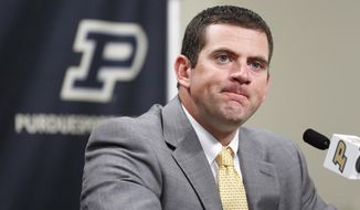 Interim head coach Gerad Parker fields questions from the media following the announcement that Darrell Hazell had been fired as head football coach Sunday, Oct. 16, 2016, at Purdue University in West Lafayette, Ind. (John Terhune/Journal & Courier via AP)