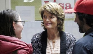 In this photo taken Monday, Oct. 17, 2016, Republican U.S. Sen. Lisa Murkowski listens during a meet-and-greet at her campaign headquarters in Juneau, Alaska. Murkowski says the presidential race has created a level of uncertainty for down-ticket races, including her own. (AP Photo/Becky Bohrer)
