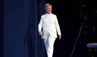 Democratic presidential candidate Hillary Clinton takes the stage for the third presidential debate at University of Nevada in Las Vegas, Wednesday, Oct. 19, 2016. (AP Photo/Andrew Harnik)