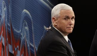 Republican vice-presidential nominee Gov. Mike Pence looks down at the debate floor from a television booth before the start of the third and final presidential debate between Democratic presidential nominee Hillary Clinton Republican presidential nominee Donald Trump in Las Vegas, Wednesday, Oct. 19, 2016. (AP Photo/John Locher)