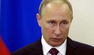 Russian President Vladimir Putin briefs the media after a meeting with the leaders of Germany, Ukraine and France in Berlin, Thursday, Oct. 20, 2016. (AP Photo/Markus Schreiber)