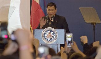 Philippine President Rodrigo Duterte addresses members of the Philippine community in Beijing, China, Wednesday, Oct. 19, 2016. Duterte's effusive message of friendship on his visit to Beijing this week has handed China a public relations bonanza just three months after Beijing suffered a humiliating defeat by an international tribunal. (AP Photo/Ng Han Guan)