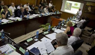 U.S. specialists in infections diseases, top left, and Cuban specialists, right, attend a meeting at the Pedro Kouri Tropical Medicine Institute (IPK) in Havana, Cuba, Wednesday, Oct. 19, 2016. The Obama administration sent some of the United States' top infectious disease specialists to Cuba to open a new phase in medical cooperation after more than a half-century of isolation .(AP Photo/Ramon Espinosa)