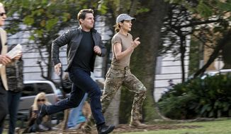 """In this image released by Paramount Pictures, Tom Cruise, left, and Cobie Smulders appear in a scene from """"Jack Reacher: Never Go Back."""" (David James/Paramount Pictures and Skydance Productions via AP)"""