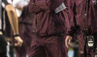 FILE - In this Saturday, Oct. 8, 2016, file photo, Virginia Tech head coach Justin Fuente watches from the sidelines during an NCAA college football game against North Carolina in Chapel Hill, N.C. Virginia Tech  faces longtime rival Miami on Thursday night in what shapes up as a must-win game for both teams. (AP Photo/Ben McKeown, File)