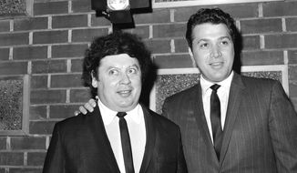 FILE - In this Dec. 10, 1965 file photo, the comedy team of Marty Allen, left, and Steve Rossi, now making their first film on the Paramount lot in Los Angeles. Allen, 94, is still making his audiences laugh six decades after hitting the big time touring with the great jazz vocalist Sarah Vaughan. (AP Photo/David F. Smith, File)