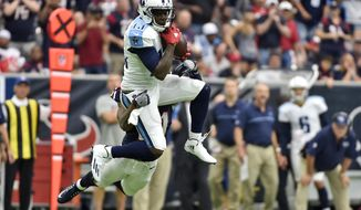 FILE - In this Oct. 2, 2016, file photo, Tennessee Titans wide receiver Kendall Wright makes a catch in front of Houston Texans cornerback A.J. Bouye (21) during the second half of an NFL football game in Houston. While his injured hamstring cost him all of the preseason and the first three games of the season, the fifth-year receiver is coming off one of the best performances of his career with the Colts coming in Sunday. (AP Photo/Eric Christian Smith, File)