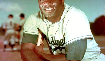 """Jackie Robinson became the first African American to play in Major League Baseball (MLB) in the modern era. Robinson broke the baseball color line when the Brooklyn Dodgers started him at first base on April 15, 1947. The Dodgers, by signing Robinson, heralded the end of racial segregation in professional baseball that had relegated black players to the Negro leagues since the 1880s. Robinson was inducted into the Baseball Hall of Fame in 1962. Robinson had an exceptional 10-year baseball career. He was the recipient of the inaugural MLB Rookie of the Year Award in 1947, was an All-Star for six consecutive seasons from 1949 through 1954, and won the National League Most Valuable Player Award in 1949the first black player so honored. Robinson played in six World Series and contributed to the Dodgers' 1955 World Series championship. In 1997, MLB """"universally"""" retired his uniform number, 42, across all major league teams; he was the first pro athlete in any sport to be so honored. MLB also adopted a new annual tradition, """"Jackie Robinson Day"""", for the first time on April 15, 2004, on which every player on every team wears No.42. (AP Photo/File)"""