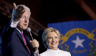 Former President Bill Clinton, left, accompanied by Democratic presidential candidate Hillary Clinton, right, speaks at debate watch party at the Craig Ranch Regional Amphitheater in North Las Vegas, Wednesday, Oct. 19, 2016, following the third presidential debate. (AP Photo/Andrew Harnik)