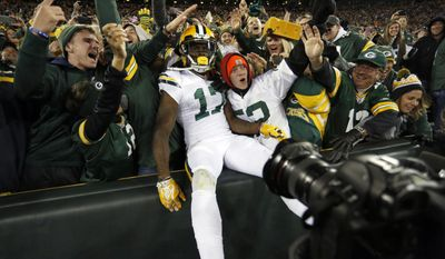 Green Bay Packers wide receiver Davante Adams (17) celebrates a touchdown with fans during the second half of an NFL football game against the Chicago Bears, Thursday, Oct. 20, 2016, in Green Bay, Wis. (AP Photo/Matt Ludtke)
