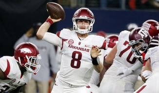 FILE- In this Sept. 24, 2016, file photo, Arkansas quarterback Austin Allen (8) throws a pass during the first half of an NCAA college football game against Texas A&M in Arlington, Texas. Allen has quickly established himself as one of the top quarterbacks in the Southeastern Conference in his first season as the starter. (AP Photo/Tony Gutierrez, File)