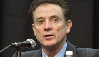 FILE - In a Friday, Feb. 5, 2016 file photo, Louisville head basketball coach Rick Pitino listens to a question during a press conference, in Louisville Ky. The NCAA accuses Louisville of providing impermissible benefits and breaches of conduct as a result of its investigation into an escort's book allegations that former men's basketball staffer Andre McGee hired her and other dancers for sex parties with Cardinals recruits and players. The NCAA sent its' Notice of Official Allegations to the school and released it on Thursday, Oct. 20, 2016. The governing body considers the breaches of conduct Level 1 infractions. The letter does not mention a lack of institutional control, considered the most serious violation, but says that Cardinals coach Rick Pitino failed to monitor McGee.  (AP Photo/Timothy D. Easley)