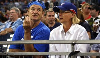 FILE - In this Aug. 19, 2009 file photo, Chicago Cubs fan and actor Bill Murray, left, talks with an unidentified woman while watching the Cubs play the San Diego Padres at a baseball game in San Diego. The Chicago Cubs are trying to do something that hasn't happened in the lifetime of anyone born in the last 108 years: Win a World Series. (AP Photo/Lenny Ignelzi, File)