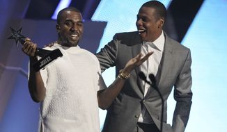 """FILE - In this July 1, 2012, file photo, Kanye West, left, and Jay-Z accept the award for best group for """"The Throne"""" at the BET Awards in Los Angeles. West told the crowd during his show in Seattle on Oct. 19, 2016, that his kids haven't played with Jay Z's daughter. (Photo by Matt Sayles/Invision/AP, File)"""