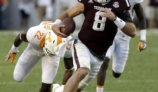 FILE - In this Oct. 8, 2016, file photo, Texas A&M quarterback Trevor Knight (8) rushes for a touchdown past Tennessee defensive back Micah Abernathy during the second half of an NCAA college football game in College Station, Texas. The sixth-ranked Aggies put their undefeated record on the line on Saturday against Alabama (7-0), the Southeastern Conference's other unbeaten team.  (AP Photo/David J. Phillip, File)
