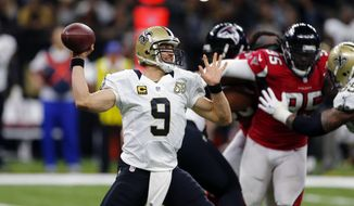 FILE - In this Sept. 26, 2016, file photo, New Orleans Saints quarterback Drew Brees passes in the first half of an NFL football game against the Atlanta Falcons in New Orleans. Brees' top three receiving targets range in age from 23 to 24, none has more than two seasons of NFL experience and one is a rookie. They way they've been playing, heading into this weekend's game at Kansas City, has the Saints' 37-year-old quarterback looking like he's still in his prime.  (AP Photo/Butch Dill, File)