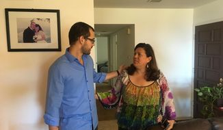 Francisco Marquez chats with his mother Maria Luz Lara-Marquez at family home in Del Mar, California, Thursday, Oct. 201.2016. The 30-year-old dual U.S. citizen spoke of his four-month incarceration in his native Venezuela, two days after he was freed and boarded a flight to join his parents in Southern California. He was arrested in June while taking part in a nationwide recall campaign against President Nicolas Maduro and accused of trying to foment violence. (AP Photo/Elliot Spagat)