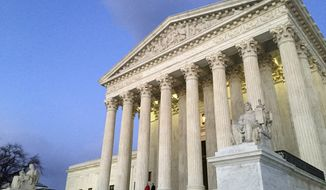 In this Feb. 13, 2016, file photo, people stand on the steps of the Supreme Court at sunset in Washington.  (AP Photo/Jon Elswick, file) **FILE**