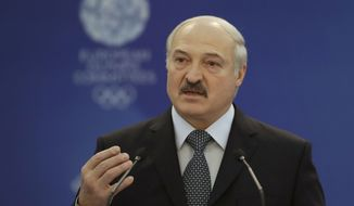 Belarus' President Alexander Lukashenko gestures while speaking at the European Olympic Committees General Assembly in Minsk, Belarus, Friday, Oct. 21, 2016. Lukashenko says his country is ready to host the 2019 European Games. (AP Photo/Sergei Grits)