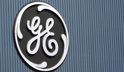 FILE - This June 24, 2014, file photo, shows the General Electric logo at a plant in Belfort, France. General Electric reports financial results Friday, Oct. 21, 2016. (AP Photo/Thibault Camus, File)