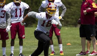 In this photo taken May 14, 2016, Washington Redskins wide receiver Josh Doctson, 18, works out during NFL football rookie minicamp, in Ashburn, Va. The Washington Redskins are putting first-round draft pick Josh Doctson on injured reserve with an injured left Achilles tendon.  (AP Photo/Jose Luis Magana)