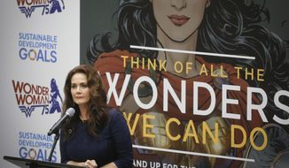 "Lynda Carter, who played Wonder Woman on television, speaks during a U.N. meeting to designate Wonder Woman as an ""Honorary Ambassador for the Empowerment of Women and Girls,"" Friday, Oct. 21, 2016 at U.N. headquarters. (AP Photo/Bebeto Matthews)"