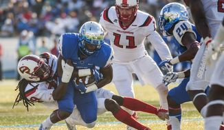 Western Kentucky defensive back Leverick Johnson (29) tackles Middle Tennessee wide receiver Dennis Andrews during WKU's 44-43 double overtime win in an NCAA college football game Saturday, Oct. 15, 2016, in Murfreesboro, Tenn. (Austin Anthony/Daily News via AP)