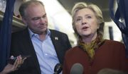 Democratic presidential candidate Hillary Clinton and Democratic vice presidential candidate Sen. Tim Kaine, D-Va. speak to reporters on board the campaign airplane, Saturday, Oct. 22, 2016, in Pittsburgh, Pa. (AP Photo/Mary Altaffer)