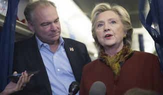Democratic presidential candidate Hillary Clinton and Democratic vice presidential candidate Sen. Tim Kaine, D-Va. speak to reporters on board the campaign airplane in this Saturday, Oct. 22, 2016 photo from Pittsburgh, Pa. (AP Photo/Mary Altaffer) **FILE*