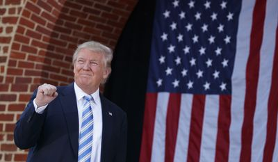 Republican presidential candidate Donald Trump arrives to speak at a campaign rally at Regent University, Saturday, Oct. 22, 2016, in Virginia Beach, Va. (AP Photo/ Evan Vucci) ** FILE **