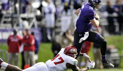 Northwestern quarterback Clayton Thorson (18) scrambles as Indiana's Robert McCray III (47) attempts a sack during the third quarter of an NCAA college football game Saturday, Oct. 22, 2016, in Evanston, Ill. (AP Photo/Paul Beaty)