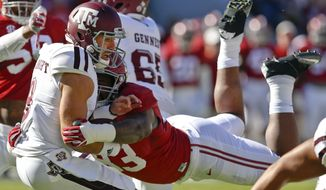 Alabama defensive lineman Jonathan Allen (93) sacks Texas A&M quarterback Trevor Knight, front left, during the first half of an NCAA college football game, Saturday, Oct. 22, 2016, in Tuscaloosa, Ala. (AP Photo/Brynn Anderson)