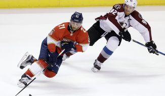 Florida Panthers center Vincent Trocheck (21) skates with the puck as Colorado Avalanche left wing Gabriel Landeskog (92) defends in the second period of an NHL hockey game, Saturday, Oct. 22, 2016, in Sunrise, Fla. (AP Photo/Alan Diaz)
